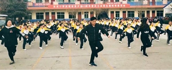 Chinese pupils perform shuffle dance