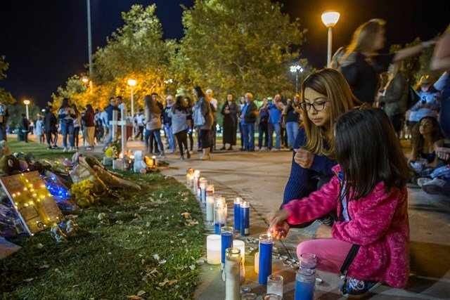 Mourners in candlelight procession for victims of high school shooting